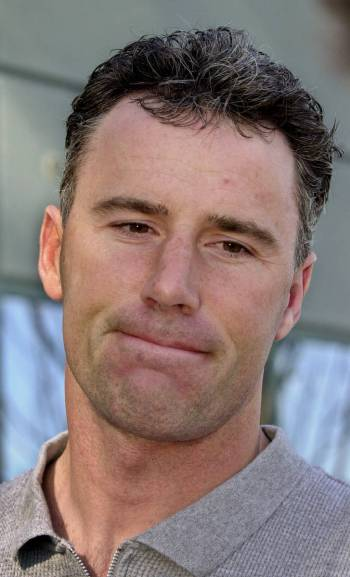 Oakland Raiders quarterback Rich Gannon answers questions after arriving at Raiders headquarter ...