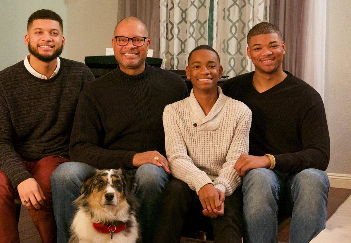 Nevada Attorney General Aaron Ford, second from left, sits with his sons, from left, Avery, Ale ...