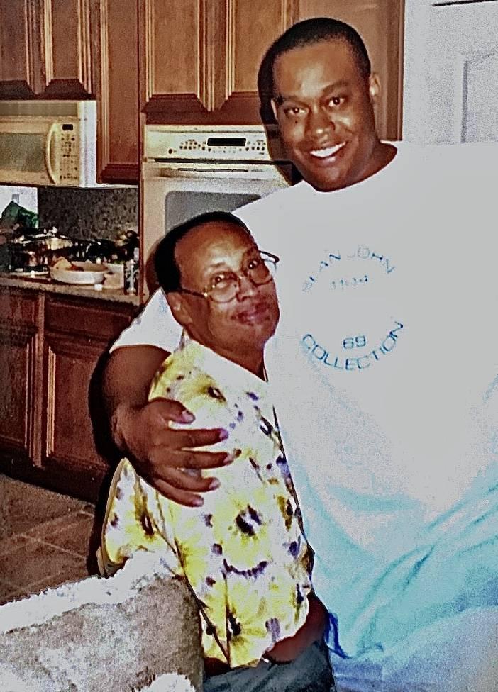 Las Vegas Councilman Cedric Crear, right, hugs his father, Dr. John Crear. (Cedric Crear)