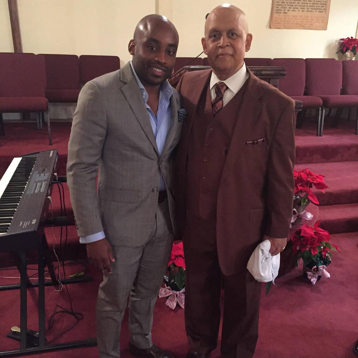 Javon Johnson, director of African American & African Diaspora Studies at UNLV, is shown with h ...