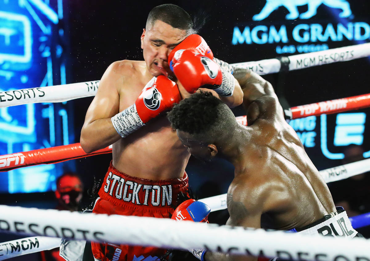 Josec Ruiz, right, connects with a punch against Gabriel Flores Jr. during their lightweight fi ...