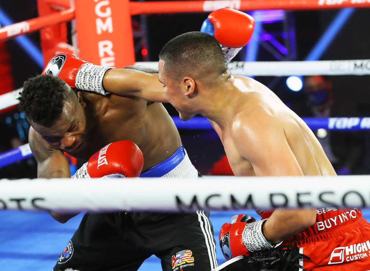 Gabriel Flores Jr., right, lands a punch against Josec Ruiz during their lightweight fight Thur ...