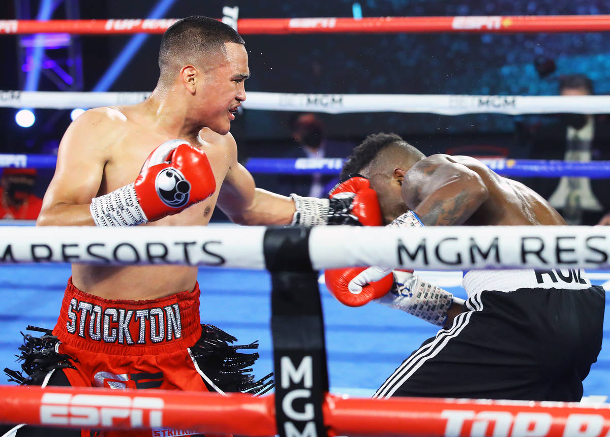 Gabriel Flores Jr., left, lands a punch against Josec Ruiz during their lightweight fight Thurs ...