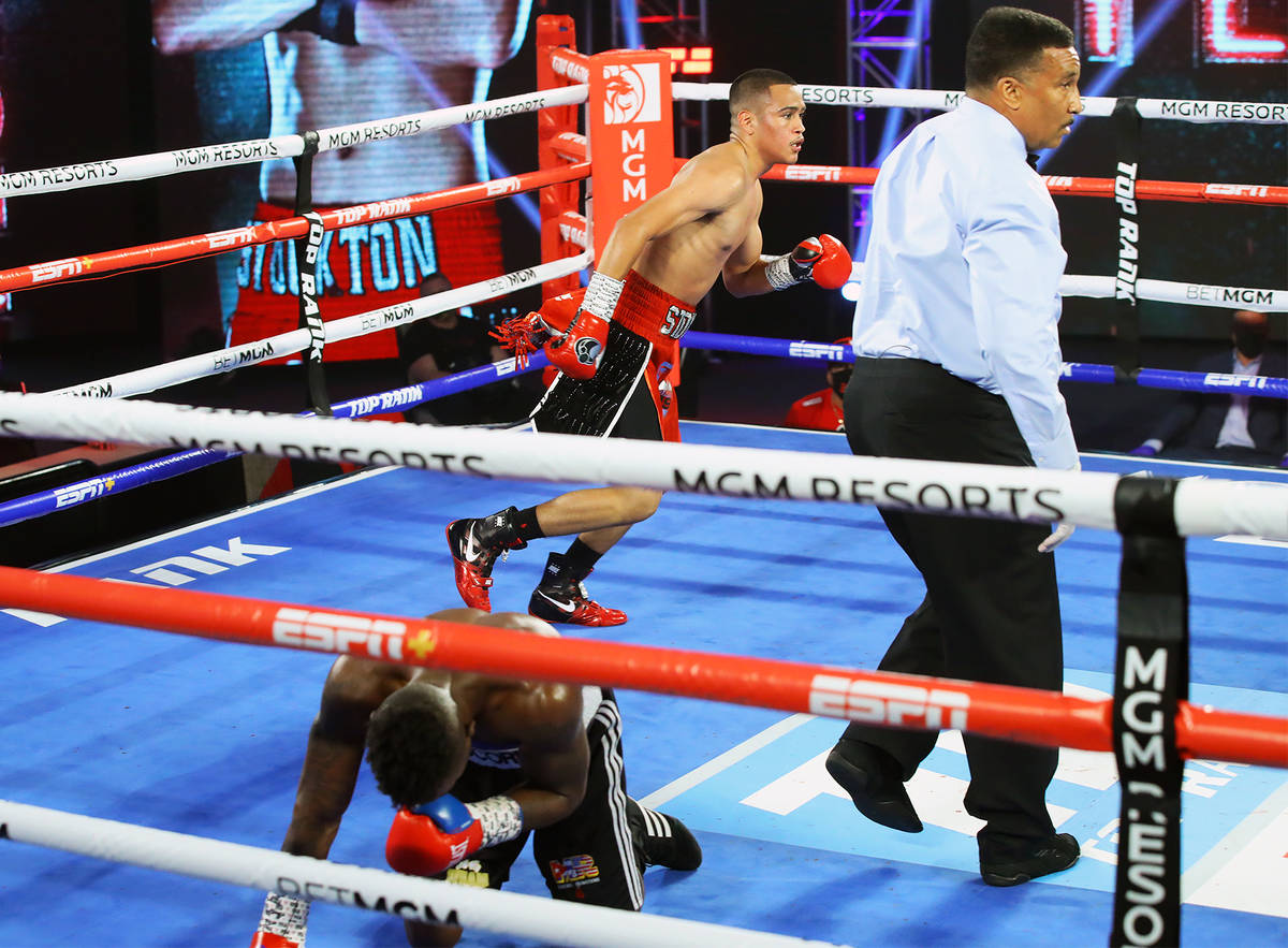Gabriel Flores Jr. knocks down Josec Ruiz during their lightweight fight Thursday, June 18, 202 ...