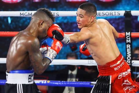Gabriel Flores Jr., right, lands a punch against Josec Ruiz during their lightweight fight Thur ...
