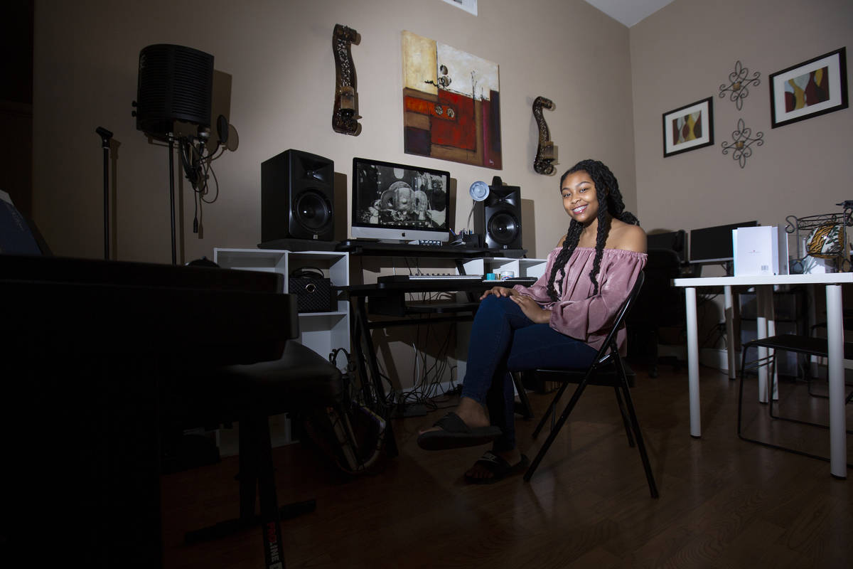 A'Kaeila Coulter, a student at Leadership Academy of Nevada, sits at the computer in her home w ...