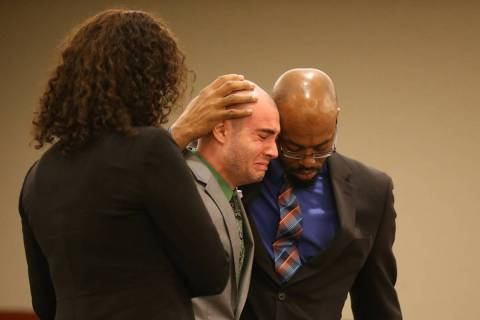 Former Las Vegas police Explorer Joshua Honea, center, reacts with his attorneys Monique McNeil ...