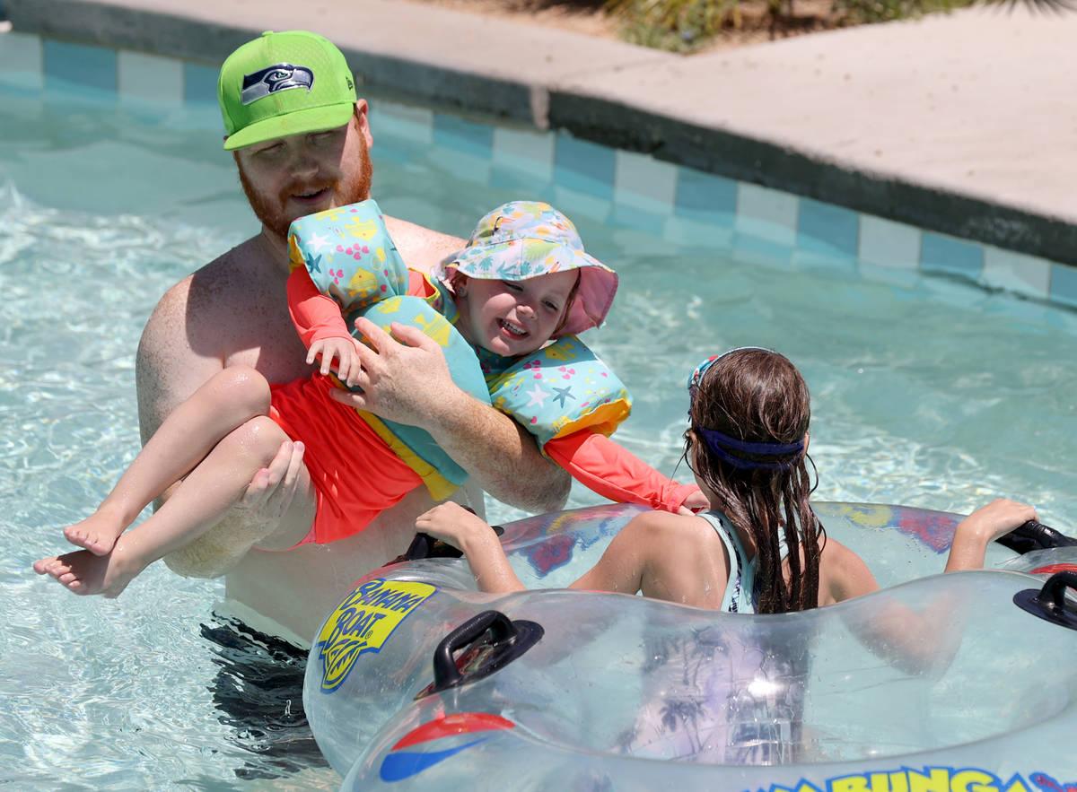 Andrew Arrington bucks off his daughter Danielle Arrington, 3, and niece Emily Artl, 6, at the ...