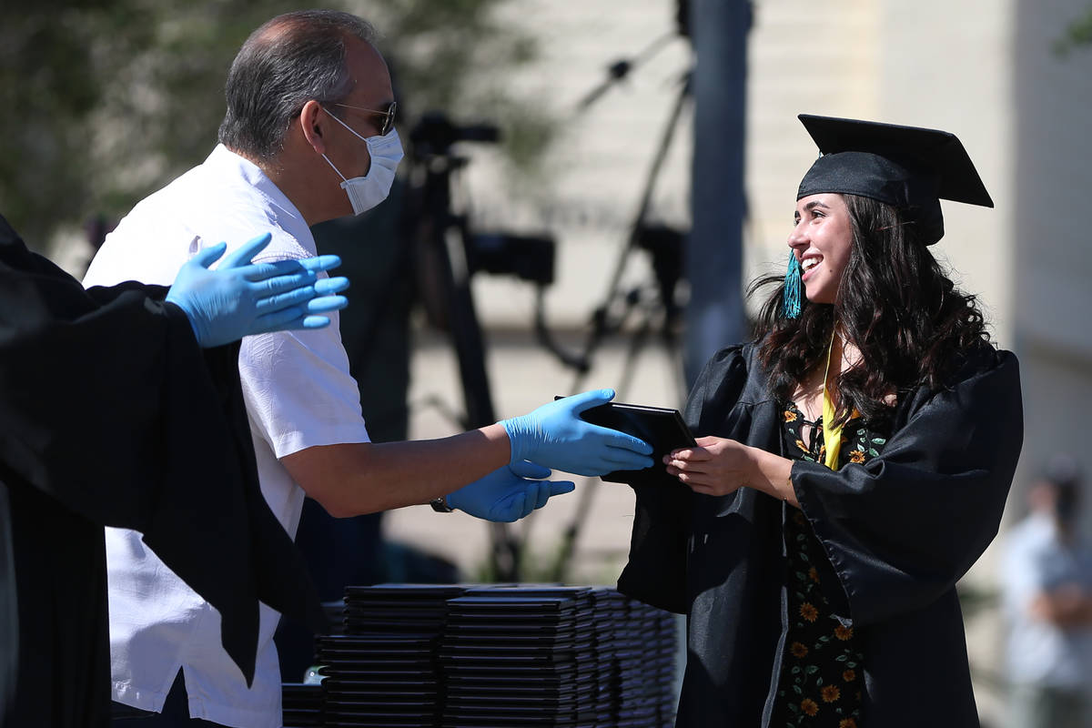 Senior Jaklyn Kittredge, right, receives her diploma from CCSD Superintendent Jesus Jara during ...