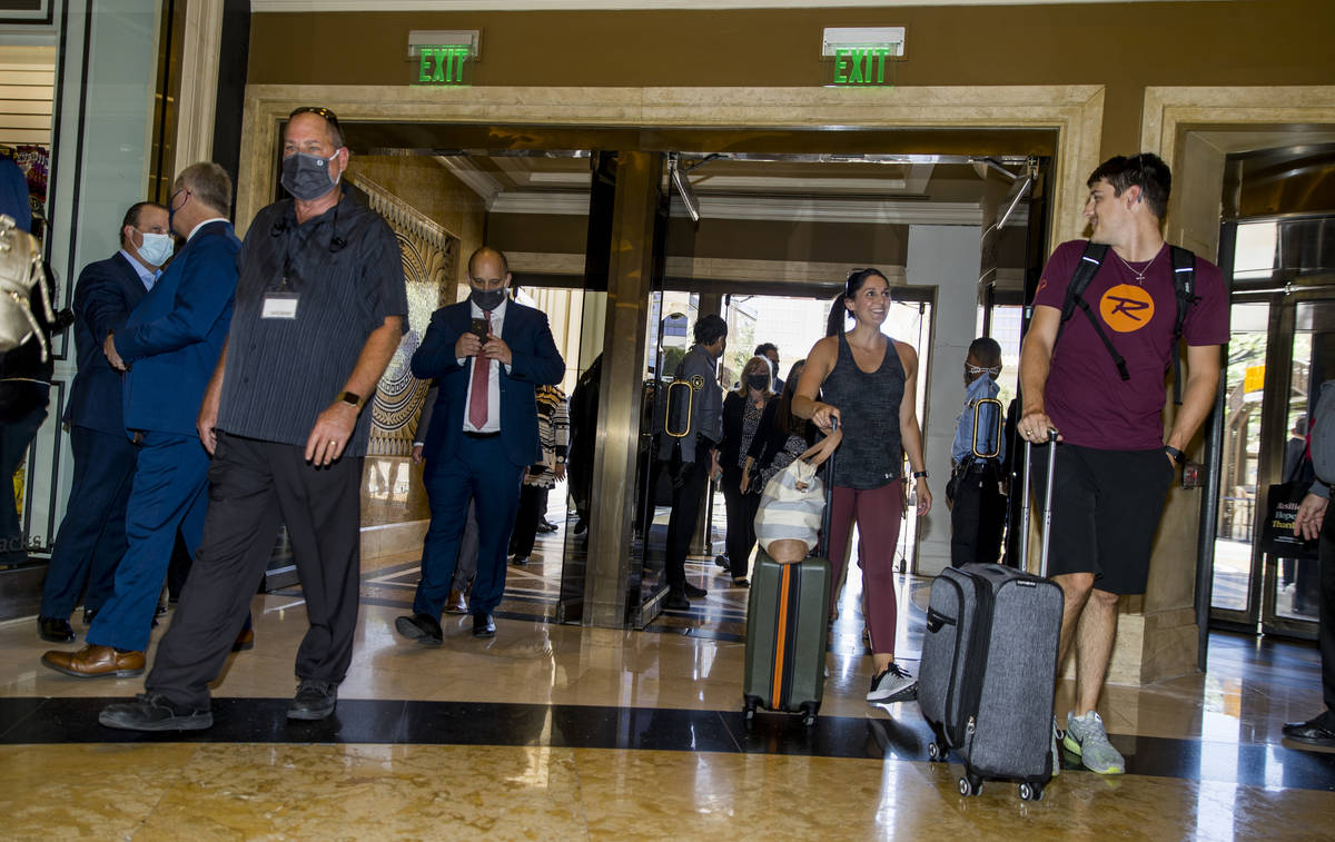 Invited guests and tourist stream into the main lobby following the reopening ceremonies at Cae ...