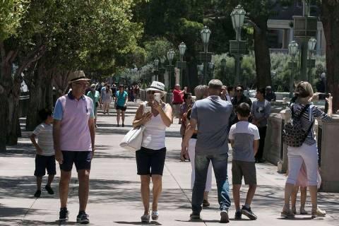 Tourists walk along Las Vegas Boulevard near the Bellagio fountains, June 7, 2020, in Las Vegas ...