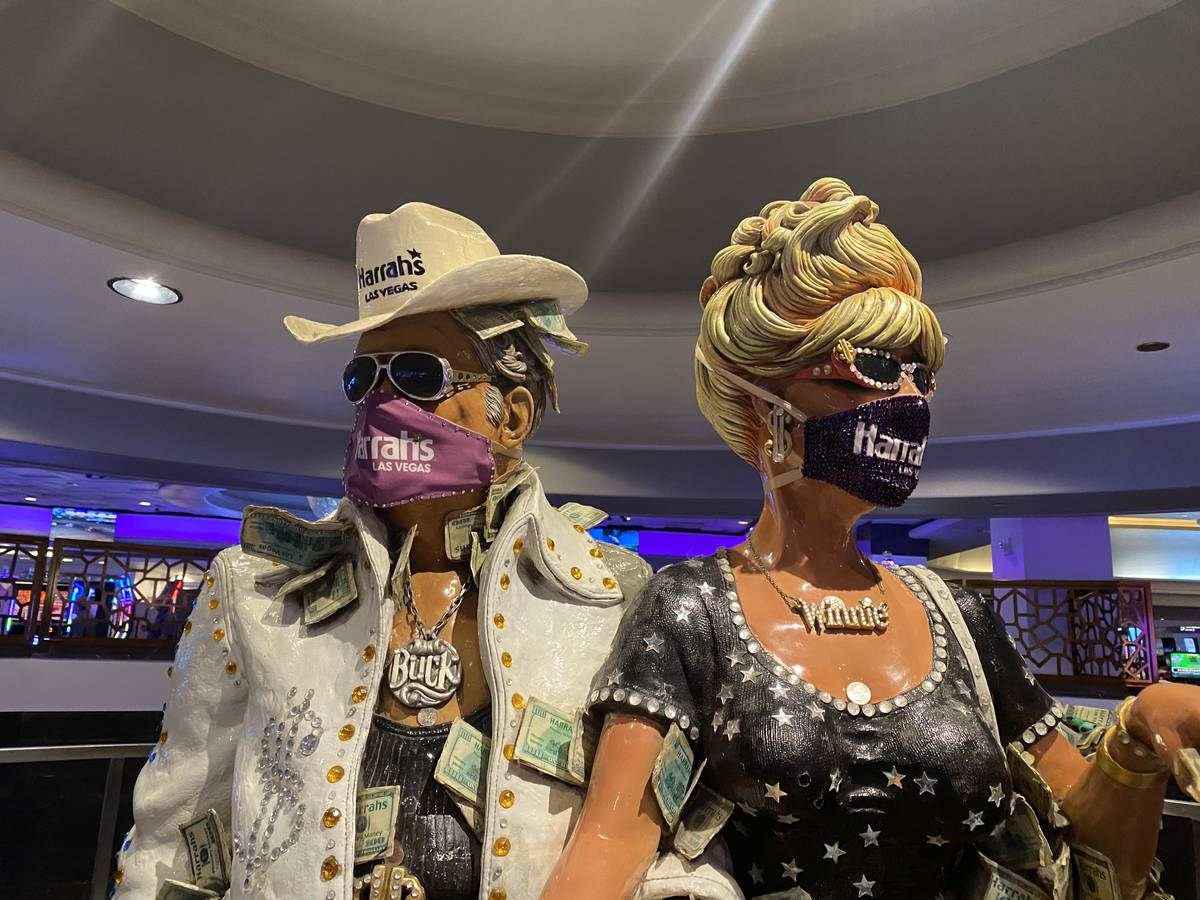The masked statues of the Greenbacks, Buck (left) and Winnie, shown Thursday, June 18, 2020. (J ...