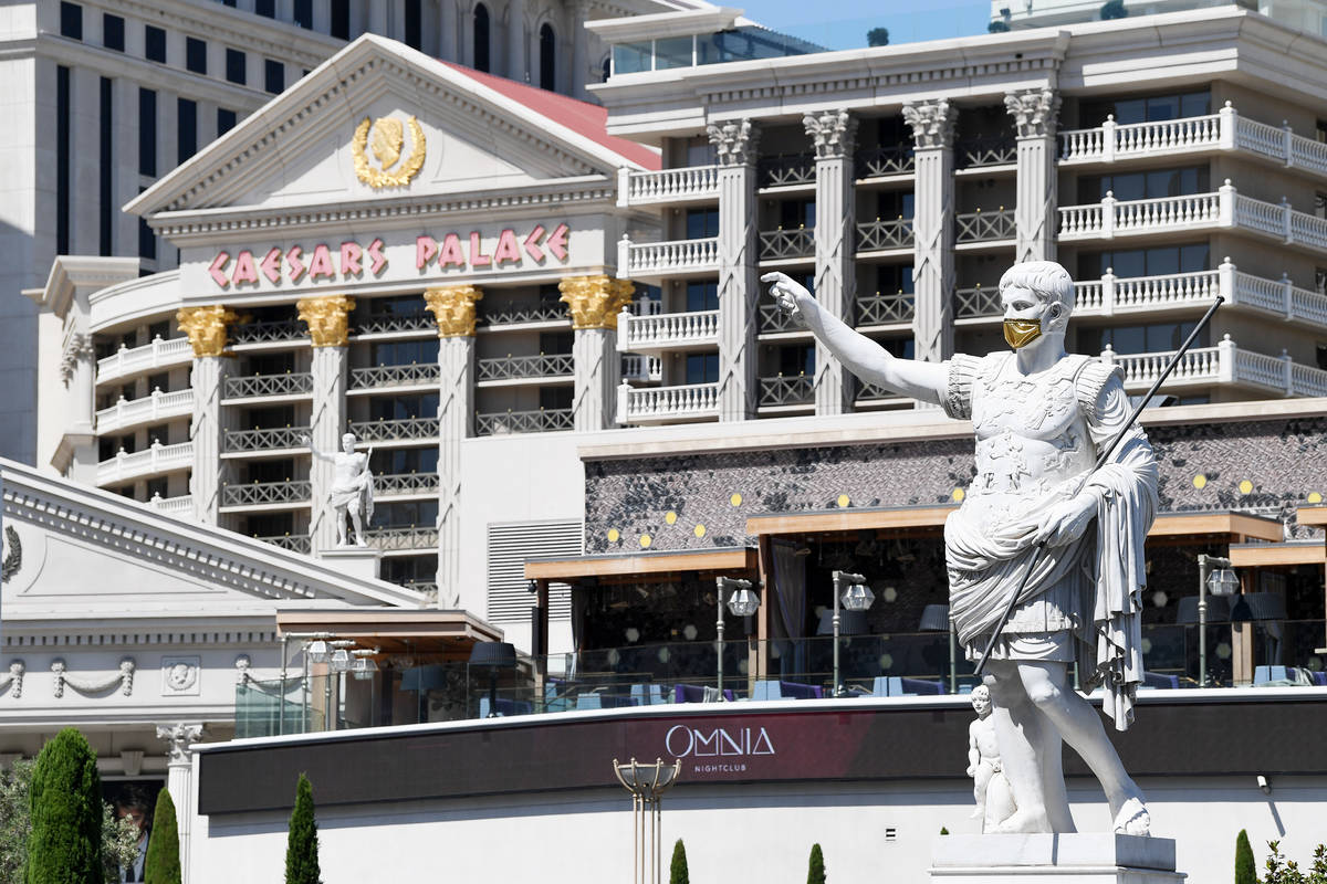 The masked Caesars statue is shown outside Caesars Palace on Thursday, June 4, 2020. (Denise Tr ...