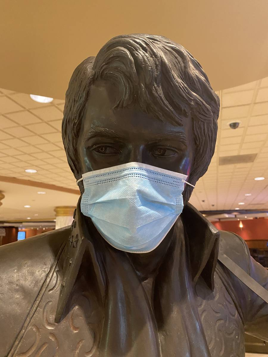 A masked statue of Elvis Presley is shown at Westgate Las Vegas on Thursday, June 18, 2020. (Jo ...