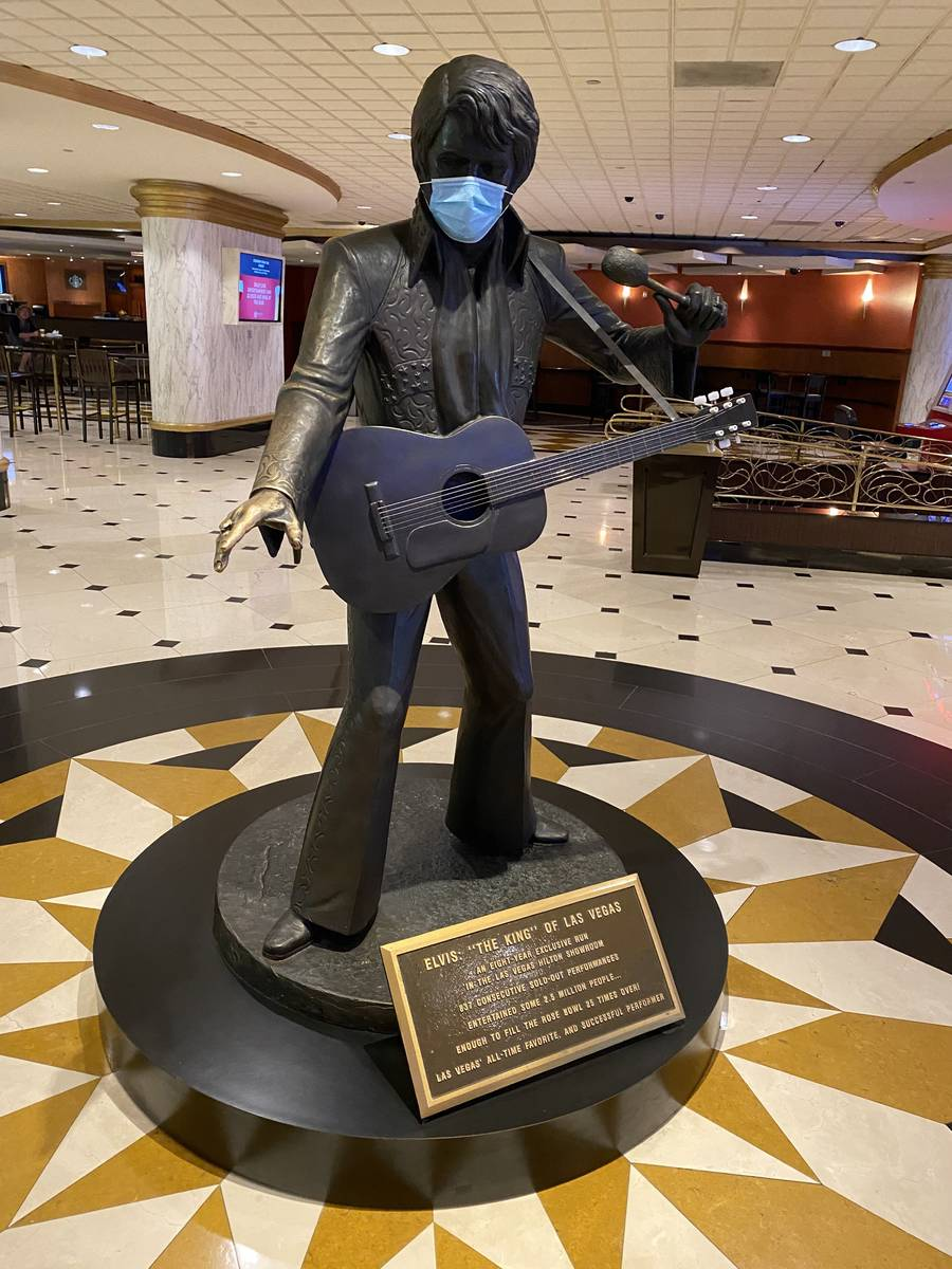 A masked statue of Elvis Presley is shown at Westgate Las Vegas on Thursday, June 18, 2020. (Jo ...