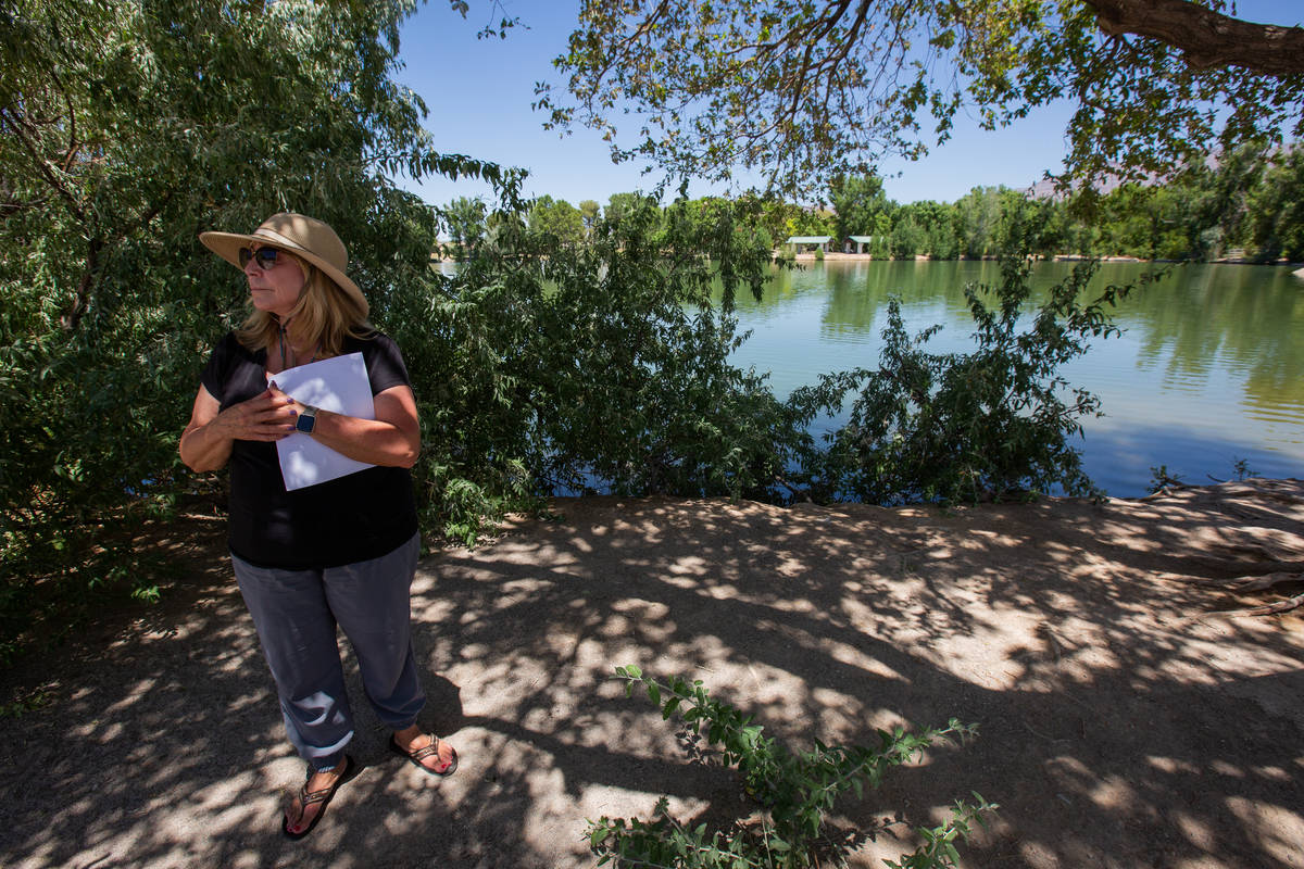 Karen Livingston, leader of the Save Floyd Lamb Park action group, stands in front of a lake in ...