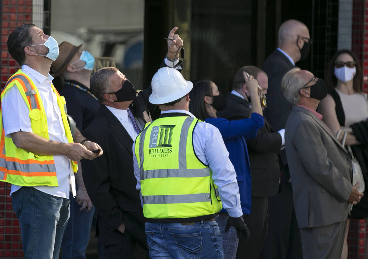 Attendees, including Derek Stevens, second left, CEO and developer of Circa Resort and Casino, ...