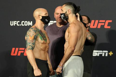 UFC featherweights Josh Emmett, left, faces off against Shane Burgos, right, as UFC president D ...