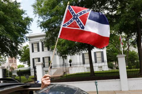 In this April 25, 2020 photograph, a small Mississippi state flag is held by a participant duri ...