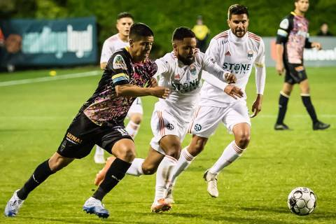 Junior Burgos of Lights FC pursues the ball during the team's only 2020 USL game before the cor ...