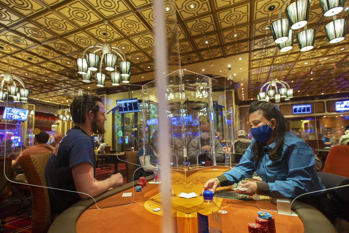 The Bellagio poker room is packed after being outfitted with shielding and upgraded sanitation ...