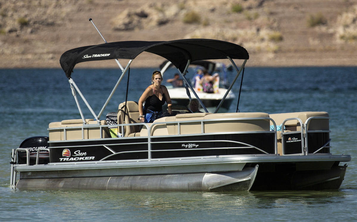 People enjoy boating at Lake Mead on Saturday, June 20, 2020, in Boulder City. Nevada is one of ...