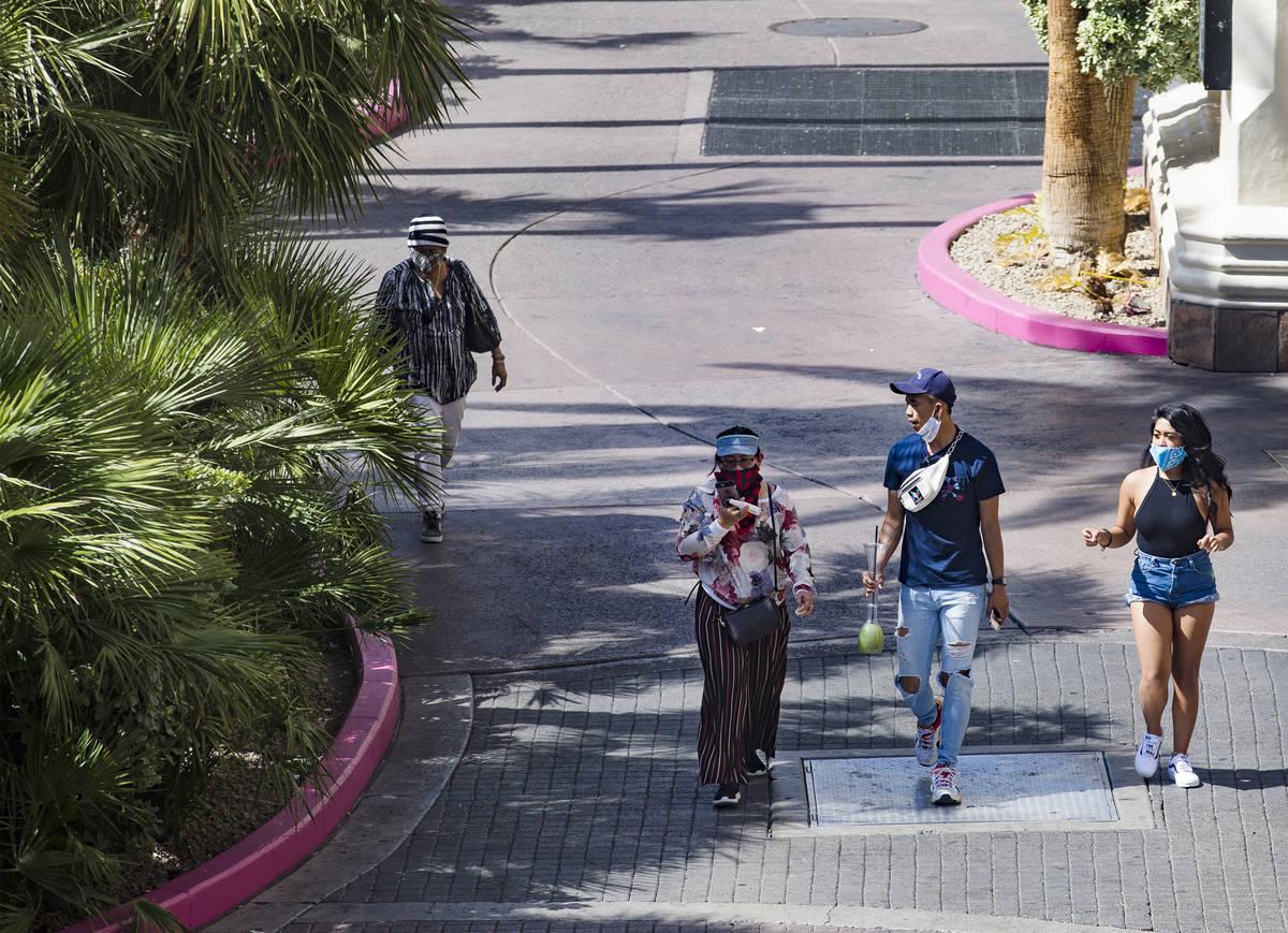 Visitors walk the Strip in Las Vegas, Sunday, June 21, 2020. (Rachel Aston/Las Vegas Review-Jou ...