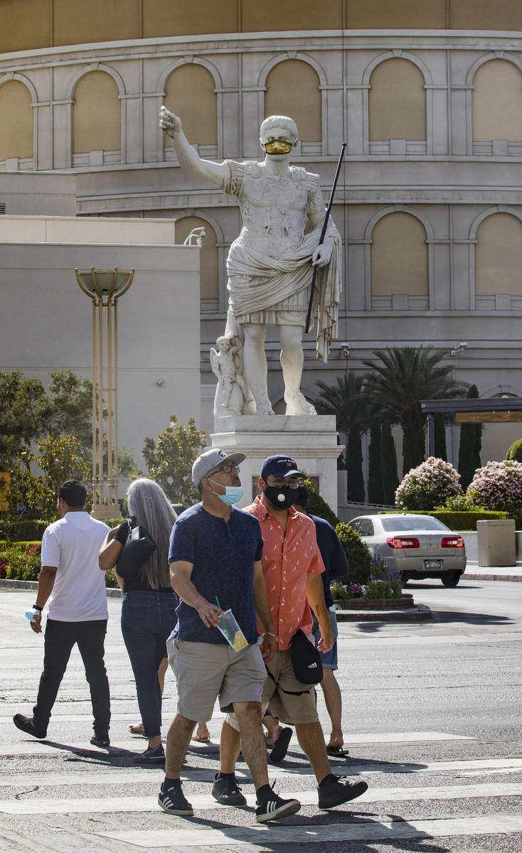 Pedestrians cross Las Vegas Boulevard in Las Vegas, Sunday, June 21, 2020. (Rachel Aston/Las Ve ...