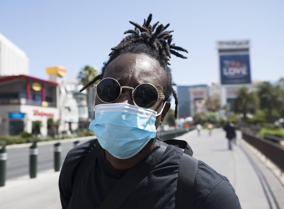 Antonio Skiiboski Wheeler, of Orlando, shows his mask on the Strip in Las Vegas, Sunday, June 2 ...