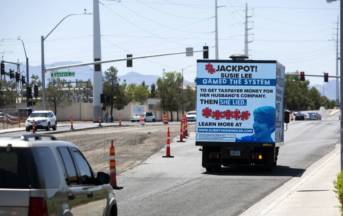 A mobile billboard attacking Rep. Susie Lee drives down Pebble Road next to Lee's office in Las ...