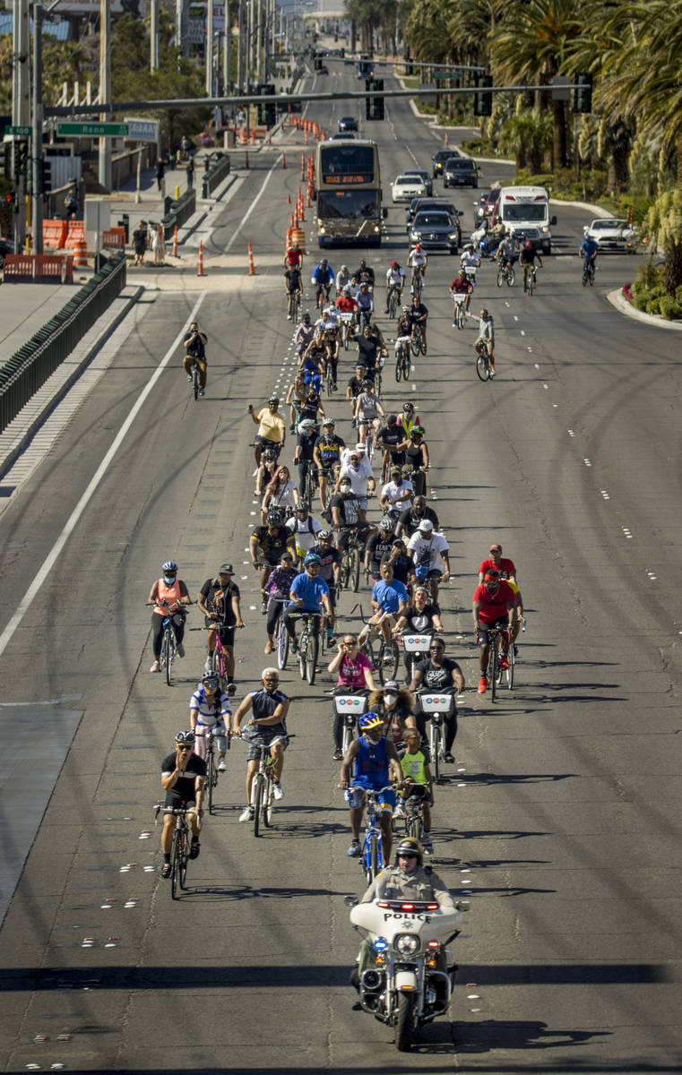 Participants in a Black Lives Matter bike ride against injustice turn at Mandalay Bay to head b ...