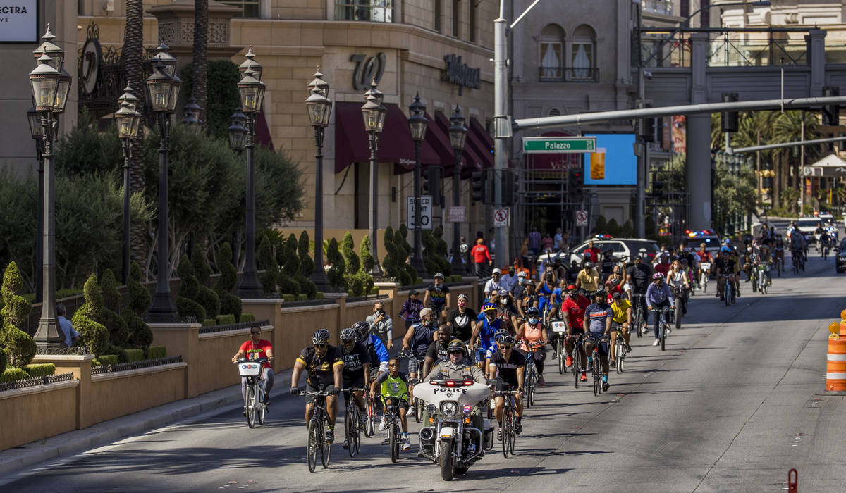 Participants in a Black Lives Matter bike ride against injustice pass The Palazzo while heading ...