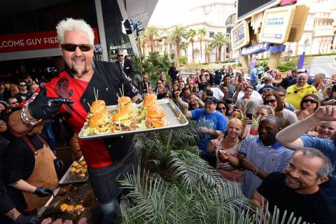 Guy Fieri serves hamburgers to guests during a welcome event for Guy Fieri's Vegas Kitchen & Ba ...