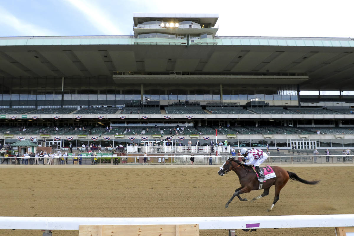 Tiz the Law (8), with jockey Manny Franco up, crosses the finish line in front of an empty gran ...