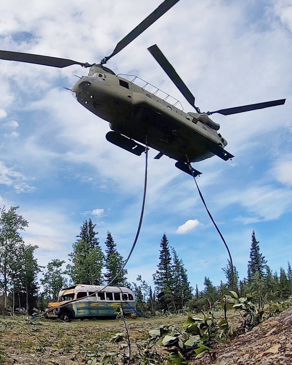 In this photo released by the Alaska National Guard, Alaska Army National Guard soldiers use a ...