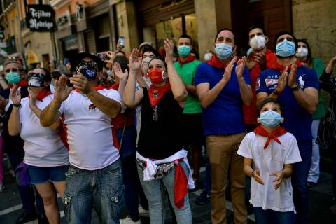 FILE In this Saturday, June 20, 2020 file photo, residents wear faces mask to protect against c ...