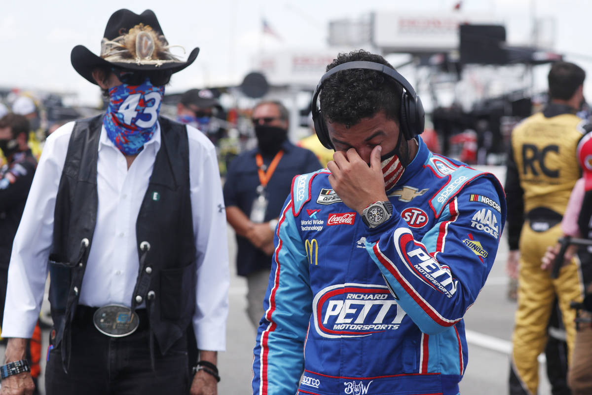 Driver Bubba Wallace, right, is overcome with emotion as he and team owner Richard Petty walk t ...