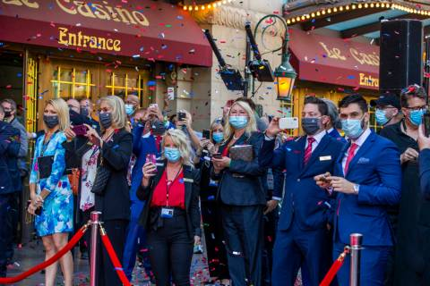 Paris Las Vegas staff look on as confetti rains down during a reopening celebration following t ...