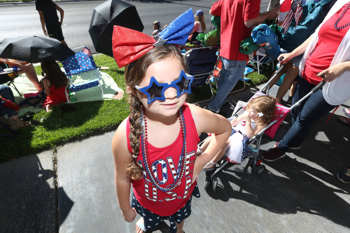 Sidonia Hambleton, 6, left, and Zella Hambleton, 2, right, wait to see floats during the 25th a ...