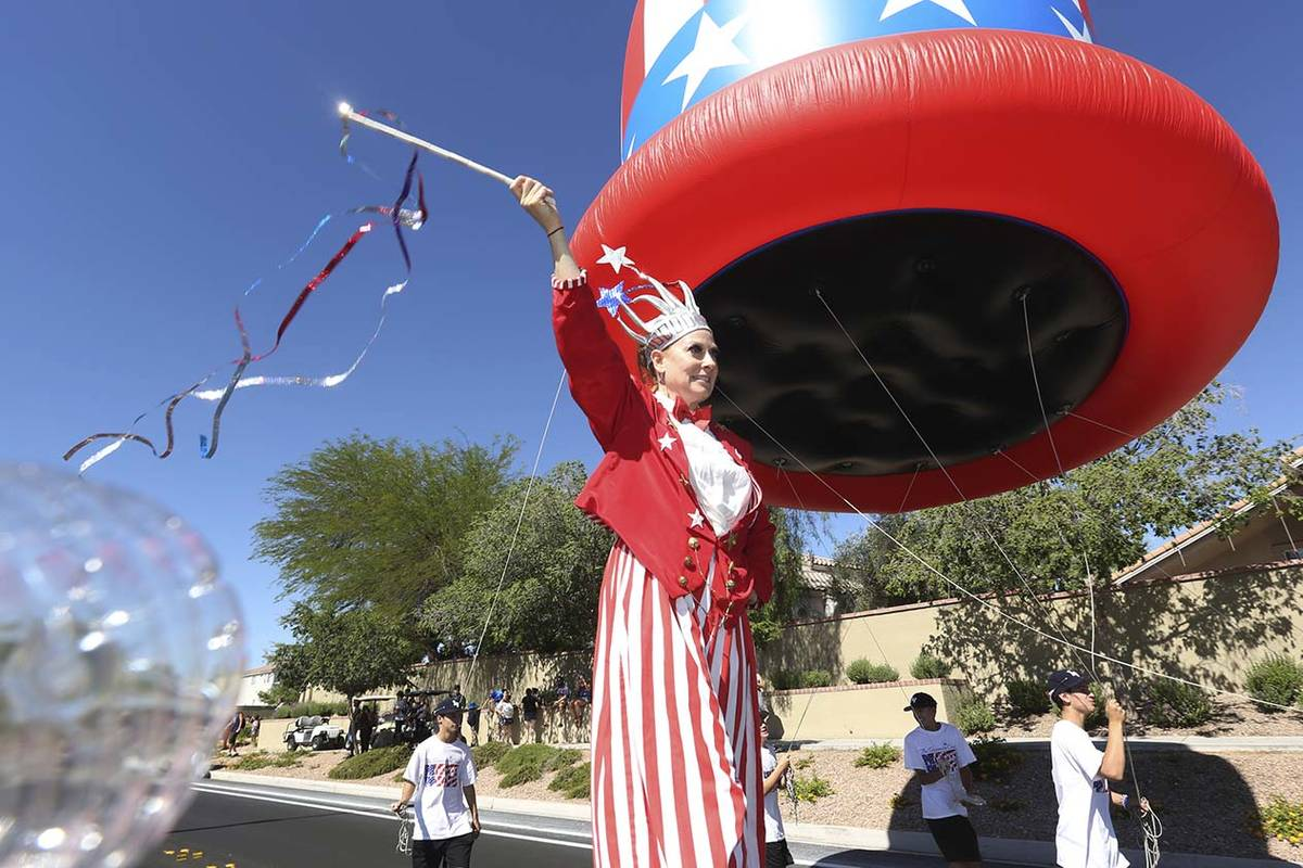 Sara Back waves her baton during the 25th annual Summerlin Council Patriotic Parade on July 4, ...
