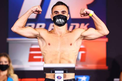 WBA super flyweight champion Andrew Moloney of Australia weighs in Monday on his title fight Tu ...