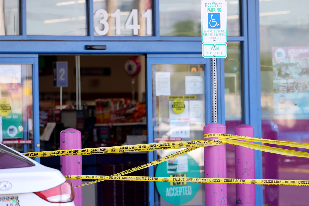 Las Vegas police investigate a shooting at the 99 Cents Only Store on North Rancho Drive at Che ...