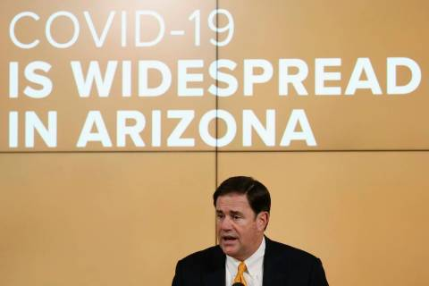 Arizona Republican Gov. Doug Ducey speaks about the latest coronavirus data at a news conferenc ...
