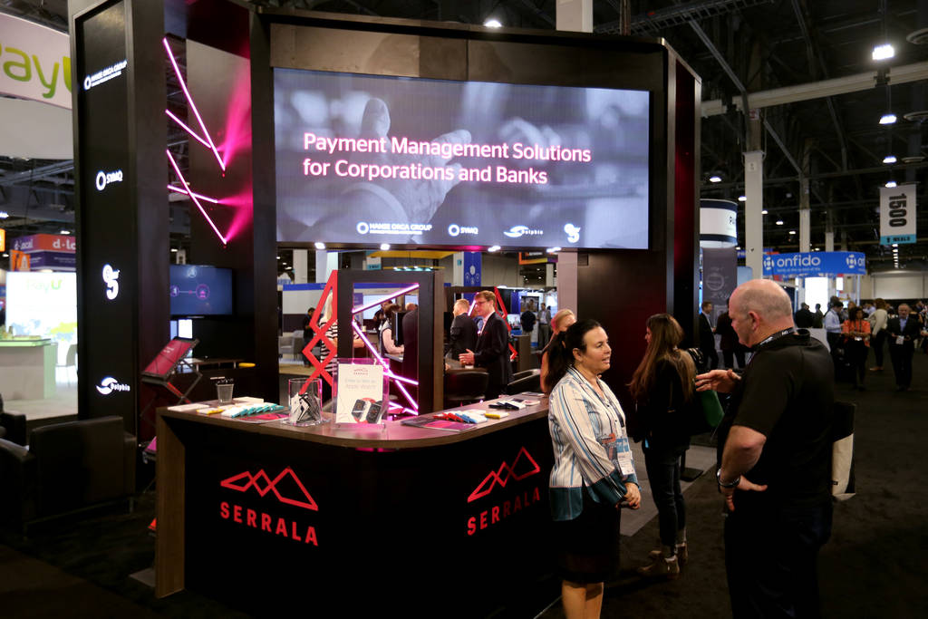 Conventioneers mingle at the Serrala booth at the Money 20/20 show at the Venetian in Las Vegas ...