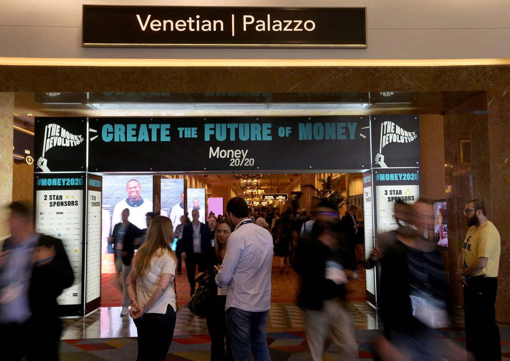 Conventioneers mingle at the Money 20/20 show at the Venetian in Las Vegas Tuesday, Oct. 23, 20 ...