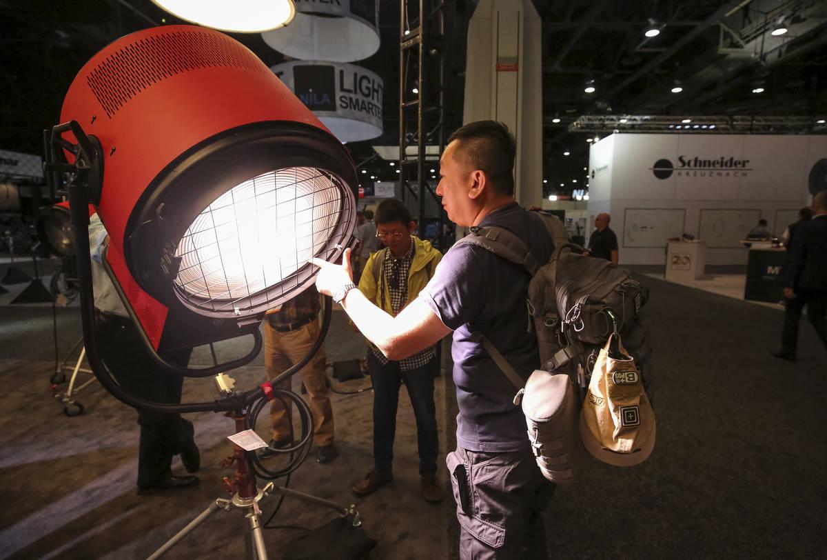 Filmmaker Paul Chou of Taiwan demonstrates Mole-Richardson's Vari-Tener 10k LED movie light dur ...