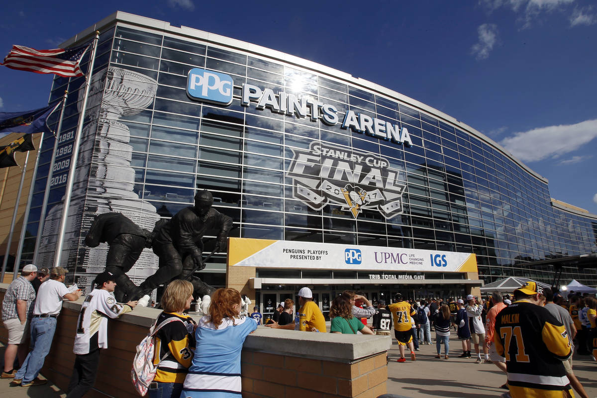 Fans wait outside PPG Paints Arena for Game 1 of the NHL hockey Stanley Cup Finals between the ...