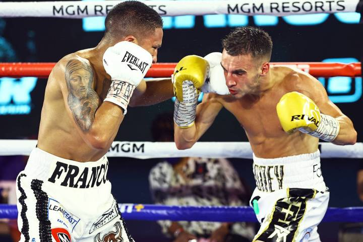 Joshua Franco, left, lands a left punch against Andrew Moloney on Tuesday, June 23, 2020, at th ...