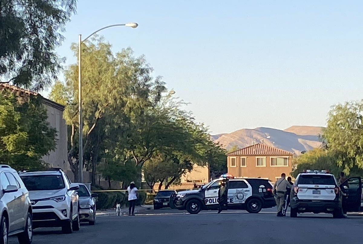 Las Vegas police have a street blocked with tape at the scene of a homicide in the 8800 block o ...