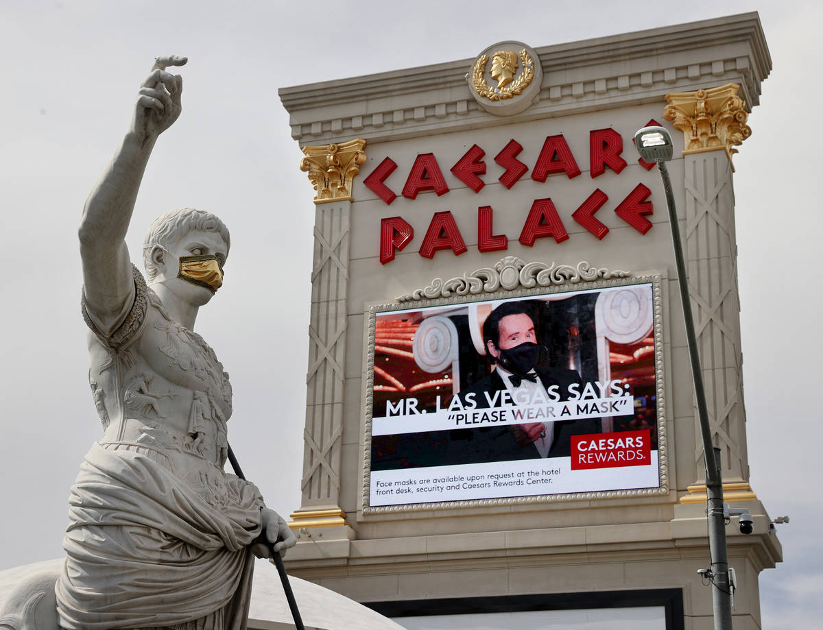 A statue of Julius Caesars dons a mask at Caesars on the Strip in Las Vegas Wednesday, June 24, ...